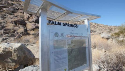 A sign marks the trailhead of the South Lykken Trail in Palm Springs. Two hikers were rescued from the Lykken Trail Tuesday night.