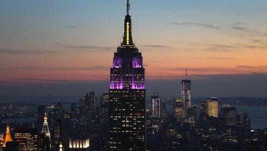 The Empire State Building towers over the Manhattan skyline.