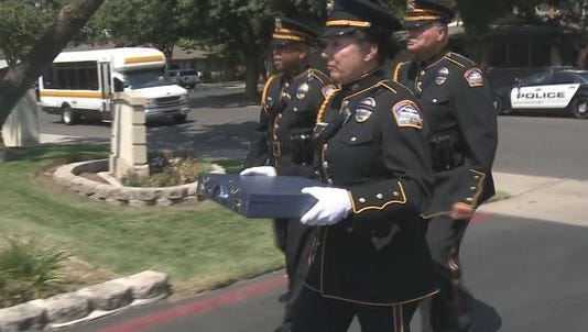 The Los Angeles Airport Police honor guard hand-delivered a briefcase of memories and photos to a Modesto man after he mistakenly left it on a plane in September of 2014.