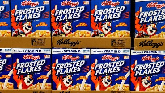 Kellogg's Frosted Flakes are stocked on shelves April 9, 2014, at a grocery store in Fargo, N.D. Kellogg said Aug. 4, 2015, that its U.S. cereal division saw another decline in quarterly sales but that trends in the category were improving.