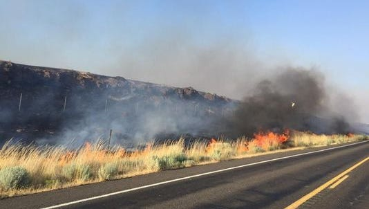 The entire town of Roosevelt was under mandatory evacuation Tuesday night after a wildfire jumped State Route 14.