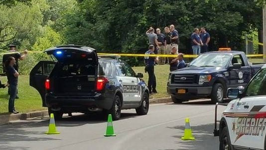 Police on scene after body found in creek.