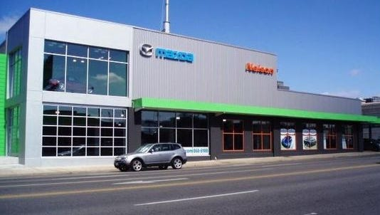 The former Nelson Mazda dealership at 1212 Broadway has a new owner, Endeavor Real Estate Group.