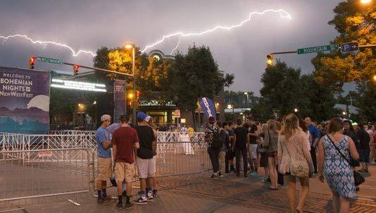 A lightning storm with light showers postponed Friday's music. There is a chance for storms this afternoon, too.