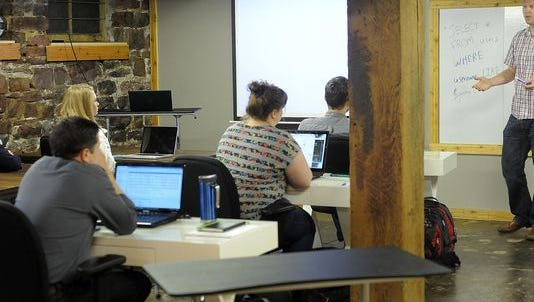 Students at the first Code Bootcamp, held in the Rock Island building downtown.