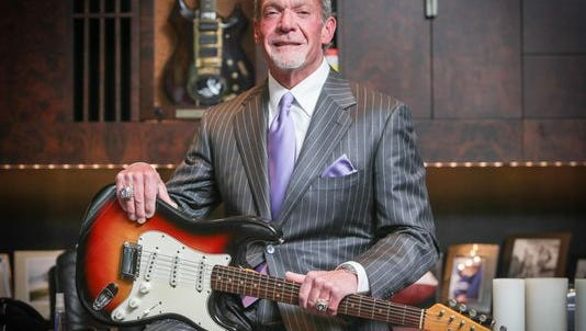 Indianapolis Colts owner Jim Irsay with his cherised Bob Dylan guitar.