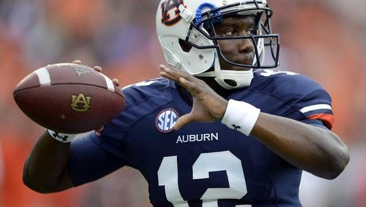 Jonathan Wallace, who started the final four games of the 2012 season, is taking practice snaps as Auburn's third-team quarterback.