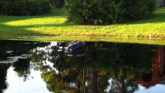 A car went into a lake near an apartment complex off Apollo Road in Florida on Wednesday morning.