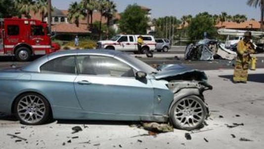 A BMW 328i was destroyed in a collision on June 18, 2013. Its driver is accused of street racing on Highway 111 before crashing into a Ford Focus, killing its passenger.