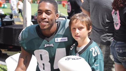 MIke Johnson, shown recently with a fan, had 1 reception for 5 yards with the Eagles in preseason.