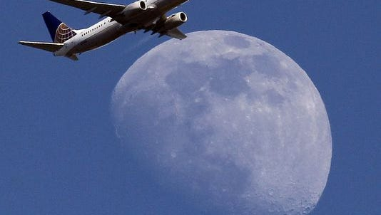 A United Airlines passenger airplane passes over Whittier, Calif., on its way to Los Angeles International Airport, Sunday, July 26, 2015.