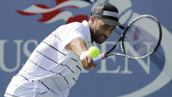 James Blake returns a shot to Lukas Lacko during the 2012 U.S. Open.