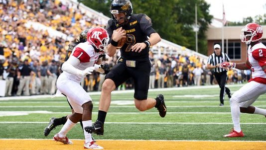 Southern Miss QB Nick Mullins scores against the  Governors Saturday.