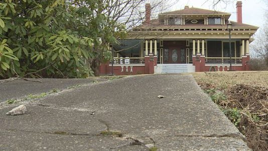 Knox Heritage says a developer has dropped plans to tear down a house to build a large retailer on Broadway.