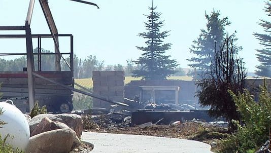 This frame from video provided by KELO-TV shows a home that burned down in a deadly fire south of Platte on Thursday. Authorities said six people died.