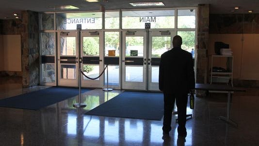 A security guard stands inside Lakewood High School in this 2012 file photo.