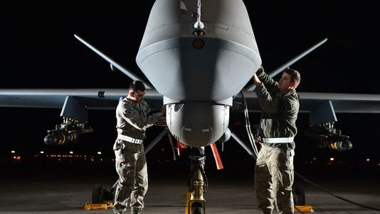 Airman 1st Class Steven, 432nd Aircraft Maintenance Squadron MQ-9 Reaper crew chief, left, and Airman 1st Class Taylor, 432nd Aircraft Maintenance Squadron MQ-9 Reaper crew chief, prepare an MQ-9 Reaper for flight during Combat Hammer last year.