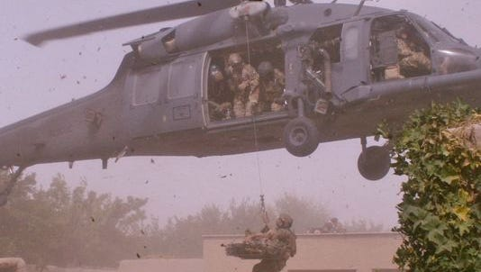 Guardian Angels hoist a wounded Danish Army Solider into a HH-60G Pave Hawk while deployed to Afghanistan.
