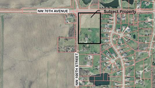 A Johnston couple wants to turn six acres of land near the intersection of Northwest 100th Street and Northwest 70th Avenue into a commercial zone, but neighbors hope a park will be built there.