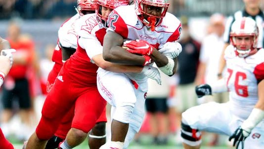 Sep 26, 2015; Bowling Green, KY, USA; Western Kentucky Hilltoppers running back D'Andre Ferby (32) carries the ball against Miami (Oh) Redhawks defensive end Quinn Calcagno (92) during the first half at Houchens Industries-L.T. Smith Stadium. Mandatory Credit: Joshua Lindsey-USA TODAY Sports