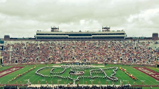 The FSU Marching Chiefs take the field during a game at halftime.