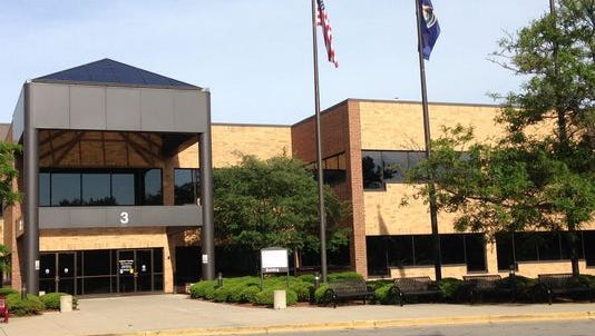 The Ingham County Human Services Building, where the Health Department is based. Those wishing to be tested should enter door 3, shown, and follow the red ribbon to Adult Health.