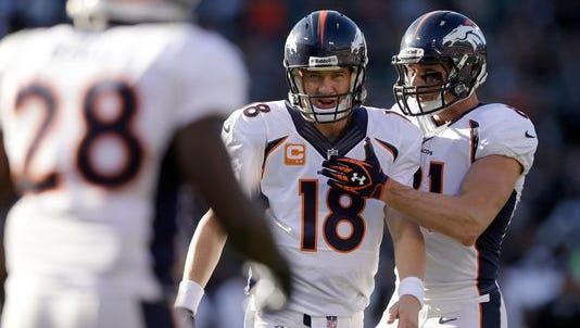 OAKLAND, CA - DECEMBER 29: Peyton Manning #18 of the Denver Broncos is congratulated by Joel Dreessen #81 after Manning threw Demaryius Thomas #88 a five-yard touchdown pass that broke the single season passing yard record during their game against the Oakland Raiders at O.co Coliseum on December 29, 2013 in Oakland, California.