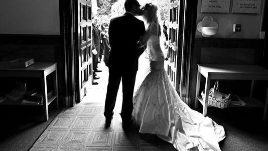Anthony D'Ambrosio shares a kiss with his former wife on their 2012 wedding day.