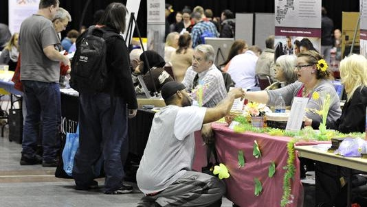 Service providers were available during Project Homeless Connect at the River's Edge Convention Center in March. The event helps people find a variety of services including job training information, health care, free cellphones and even haircuts.