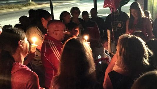 Family members and friends mourned along East Basin Road, where Melissa Livingstone was struck and killed by a car in early September.