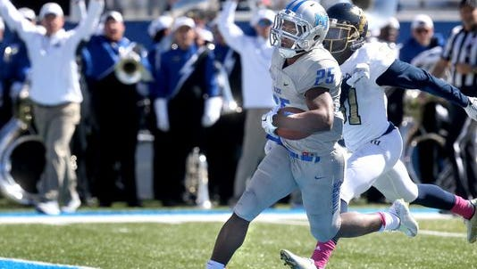 MTSU's Desmond Anderson (25) runs across into the endzone to score his 3rd touchdown as FIU's Tyree Johnson (31) tries to catch up to Anderson in the first half of an NCAA college football game against FIU, on Saturday, Oct. 17, 2015, in Murfreesboro, Tenn.