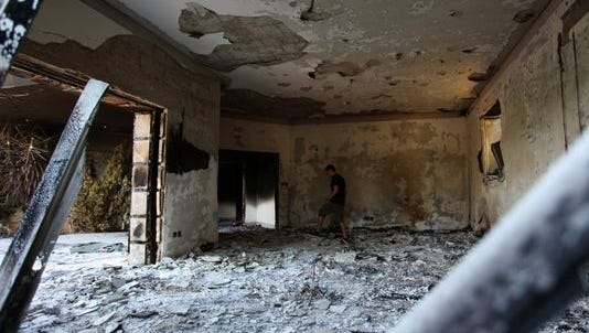 In this Sept. 13, 2012, file photo, a Libyan man walks in the rubble of the damaged U.S. consulate, after an attack that killed four Americans, including Ambassador Chris Stevens on Sept. 11, 2012, in Benghazi, Libya.