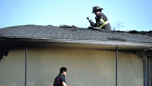 Firefighters work a fire at the Travelodge near Interstate 24 and Harding Place in Nashville on Oct. 20, 2015. Two firefighters suffered minor injuries.