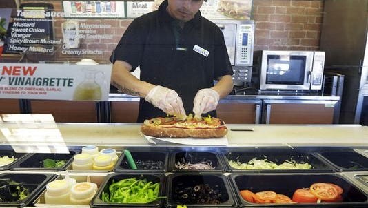 Subway will start to measure its foot-long subs.