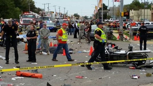 A woman police say was driving drunk plowed into a crowd at the Oklahoma State University homecoming parade, killing four.