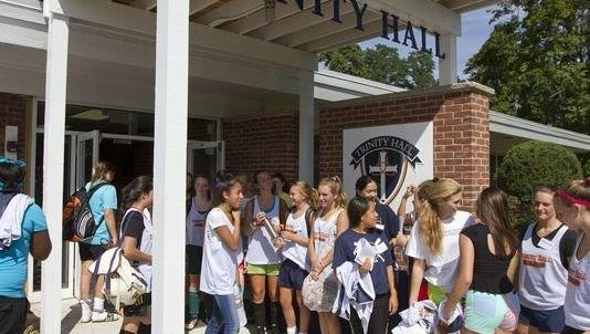Students enter the temporary home of Trinity Hall in the Leonardo section of Middletown in 2013.