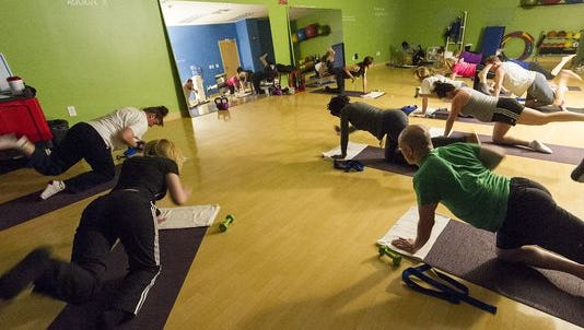 At RCI headquarters on North Michigan Road, perks include an on-site nurse practitioner for medical care, a meditation room, a massage room, a fitness center, classes in yoga (pictured) and other wellness programs.