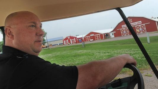 Sioux Empire Fair Association president and CEO Scott Wick earlier this year shows buildings at the W.H. Lyon Fairgrounds that were damaged from last year's hail storm.