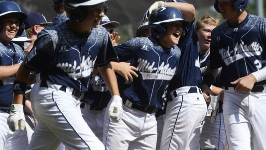 Red Land's Dylan Rodenhaber is cheered on by his teammates after hitting a grand slam during the Little League World Series Championship in Williamsport on Aug. 30.