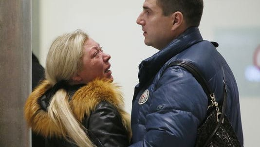 Relatives react after a Russian airliner with 217 passengers and seven crew aboard crashed, as people gather at Russian airline Metrojet information desk at Pulkovo airport in St. Petersburg, Russia, Oct. 31, 2015.