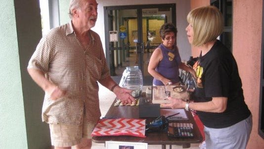 Mesquite Mayor Al Litman purchases books from last year's Mesquite Chamber of Commerce's book sale.