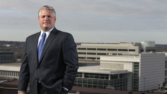 Chris Littlefield, CEO of Fidelity & Guaranty Life, poses for a picture at the Ruan Building on Wednesday, Oct. 29, 2014 in downtown Des Moines, Iowa.