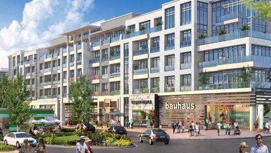 A rendering of the Ovation mixed-use project shows retail shops at the bottom with apartments above.