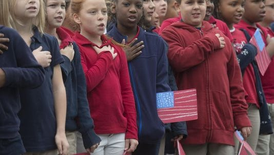 State legislators seeking to change Florida Statute concerning notifying students of right to not recite Pledge of Allegiance.