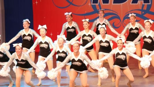 The Ankeny Centennial High School dance team performs its pom routine at the National Dance Alliance National Championship in Orlando, Fla.
