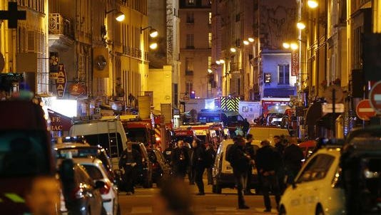 Police and emergency workers outside Bataclan concert hall in central Paris.