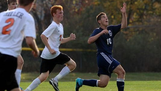 Richmonds' Matthew Schuster tries to gain possession of the ball Monday, Oct. 12 during high school soccer action at Almont.