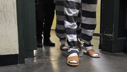 Inmates enter the Minnehaha County Jail in Sioux Falls, SD; Tuesday, Sept. 15, 2015.