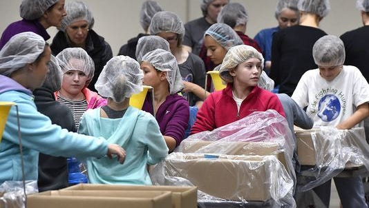 Volunteers gather to produce packages of dried food in November during a Kids Against Hunger event at the River's Edge Convention Center in St. Cloud.