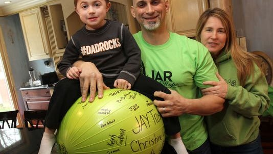 Jamesy Raffone (left) with dad Jim and mom Karen in their Manalapan home.